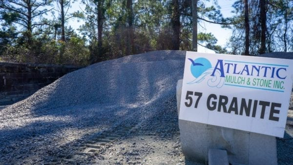 57 granite mound with Atlantic Mulch & Stone sign to the right